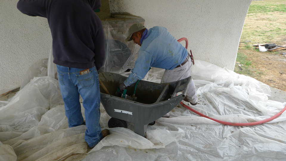 Scooping the concrete out of the mixer or wheelbarrow makes loading very fast. This ability to load the sprayer quickly hastens the completion of a project.