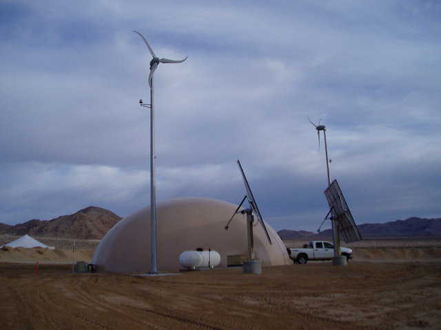 At Fort Irwin, Colorado, this 75-foot-diameter dome is equipped with windmills and solar collectors.