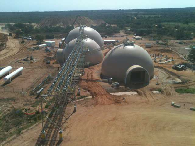 Each Monolithic Dome stores thousands of tons of frac-sand. Note the huge conveyors, resting on the domes, that carry the sand. This is a very special storage system for a very special product: frac-sand.