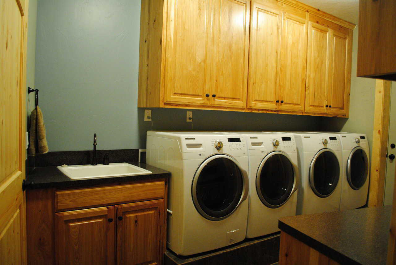 The laundry area includes multiple washers and dryers.