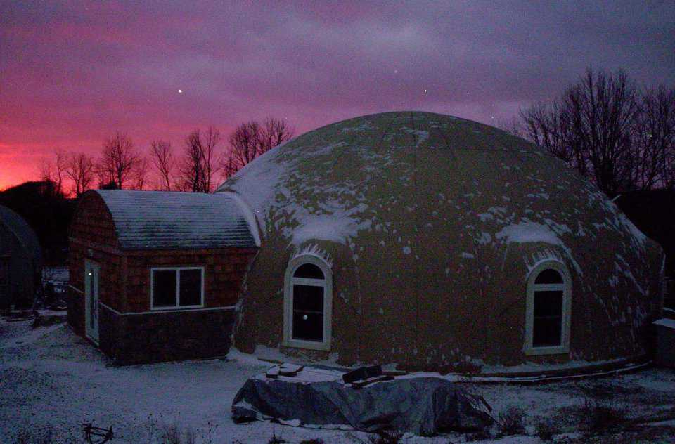 "Serenity Dome, a Callisto-style 2/5 oblate ellipse. It has a diameter of 50 ft, 28,700+ cubic feet, 2675 ft2 of floor area, and 103 yds3 of concrete in the shell and floor for thermal battery. According to Chris, ""Serenity Dome uses about 1/3 the energy of our previous brick-and-stick built home in Virginia Beach. It's tough to find an investment like a Monolithic Dome!"