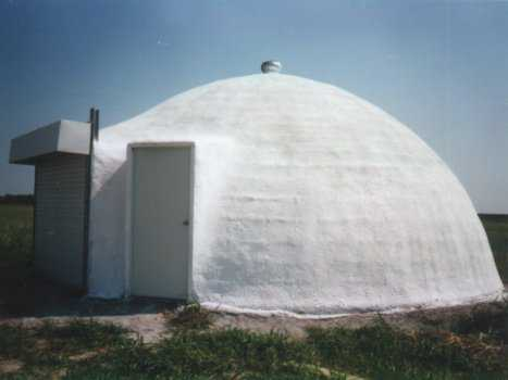 Shown here is an Ecoshell with a 20' diameter. It's one of the first ones we built as a commercial building. Notice that it is spherical in shape. Made as an Ecoshell I, it was built during a Monolithic Workshop, here at our plant in Italy, Texas. It is about 20 years old and has worked very well for us. The structure was painted with a white exterior coating.