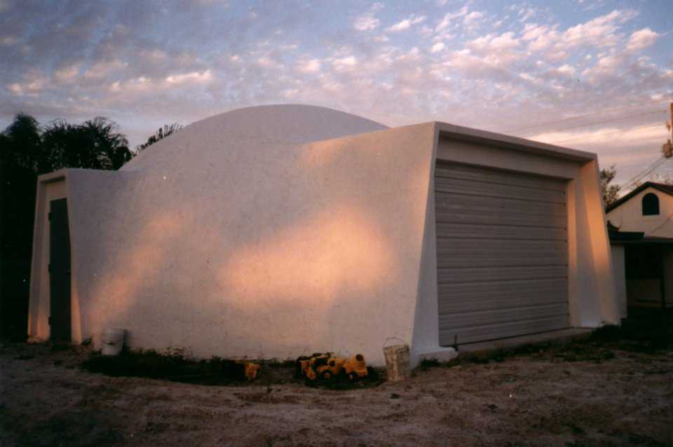 This is a 40' diameter Ecoshell that has been modified with two augmentations. It is an Ecoshell I that allows for the addition of the augmentations without modifying the Airform. It has  been coated with a tan color.