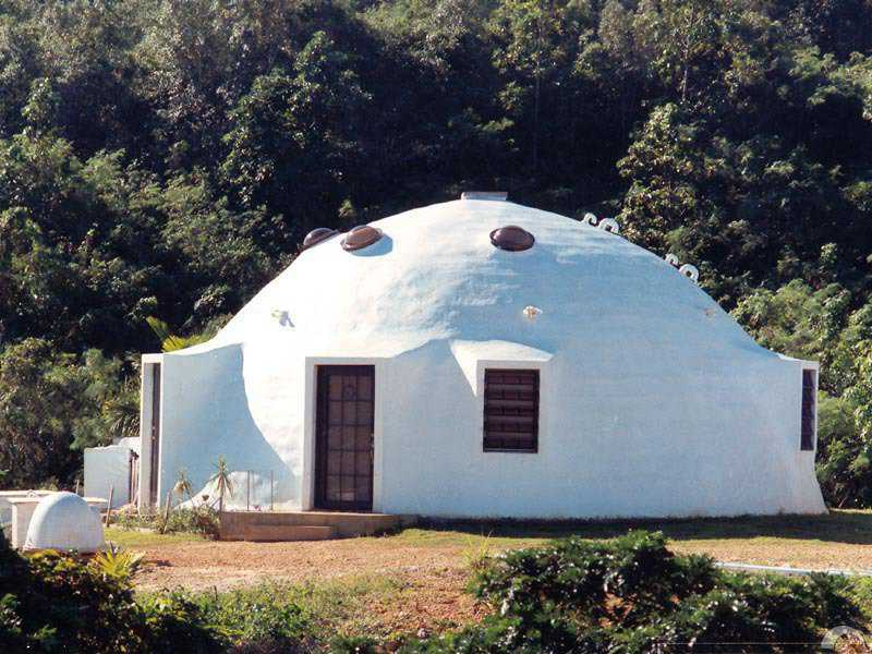 This is a 40' diameter Ecoshell I, with augmentations added to the Airform. It was spray-coated with a polyurethane. The owner has told me that he would never do that again, but would build a Monolithic Dome. We suggest strongly that Ecoshells be built as Ecoshells and not modified into Monolithic Domes, as the cost and the problems are huge.