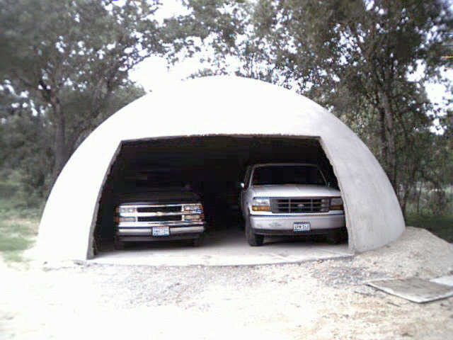 This is a 30' diameter Ecoshell. It works extremely well as a garage. You can put a Monolithic Rotating Door on this building.