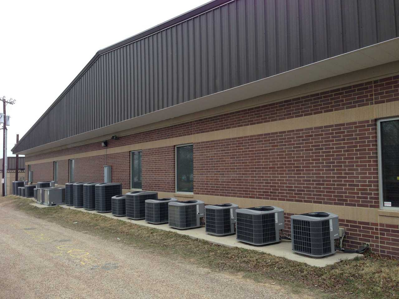 This Texas school has two conventional buildings, each with 20 air conditioning units along its back wall. That's 40 units for just one tax-supported school! What does it cost to install and run 40 ac units in hot, humid Texas? Also, consider that this is a school for less than 300 students.