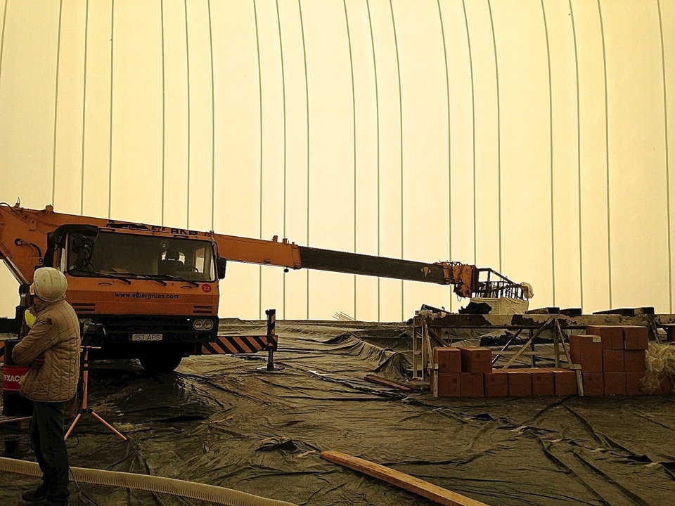 Airforms are spread over the equipment used to build the dome.