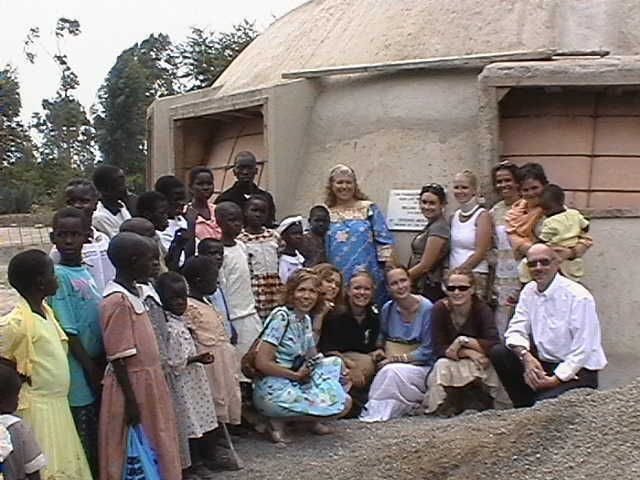 Work crew, children and leaders of WYI gather in front of Monolithic EcoShell which will soon be home to the children.