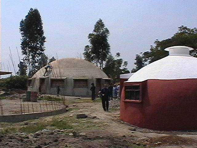 Kitchen dome exterior is complete. Children's dormitories under construction.