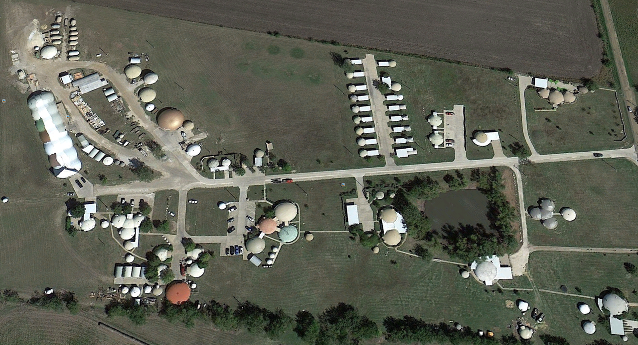 This is an aerial view of Monolithic's headquarters in Italy, Texas. Our campus includes our offices; training center; Bruco, our Airform factory; both large and small Monolithic Dome homes and rentals. Research is a prime activity and goal. For example, we check the practicality and durability of items such as exterior finishes, smoke detectors, water purifying systems, etc.