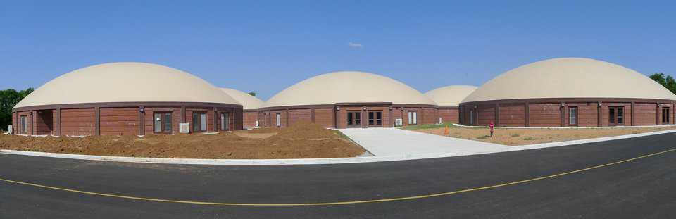 In 2011, construction began on Locust Grove's new elementary school – a complex of five, interconnected Monolithic Domes designed by Architect Lee Gray of Salt Lake City, Utah.   See: http://www.monolithic.com/stories/feature-school-locust-grove-oklahoma