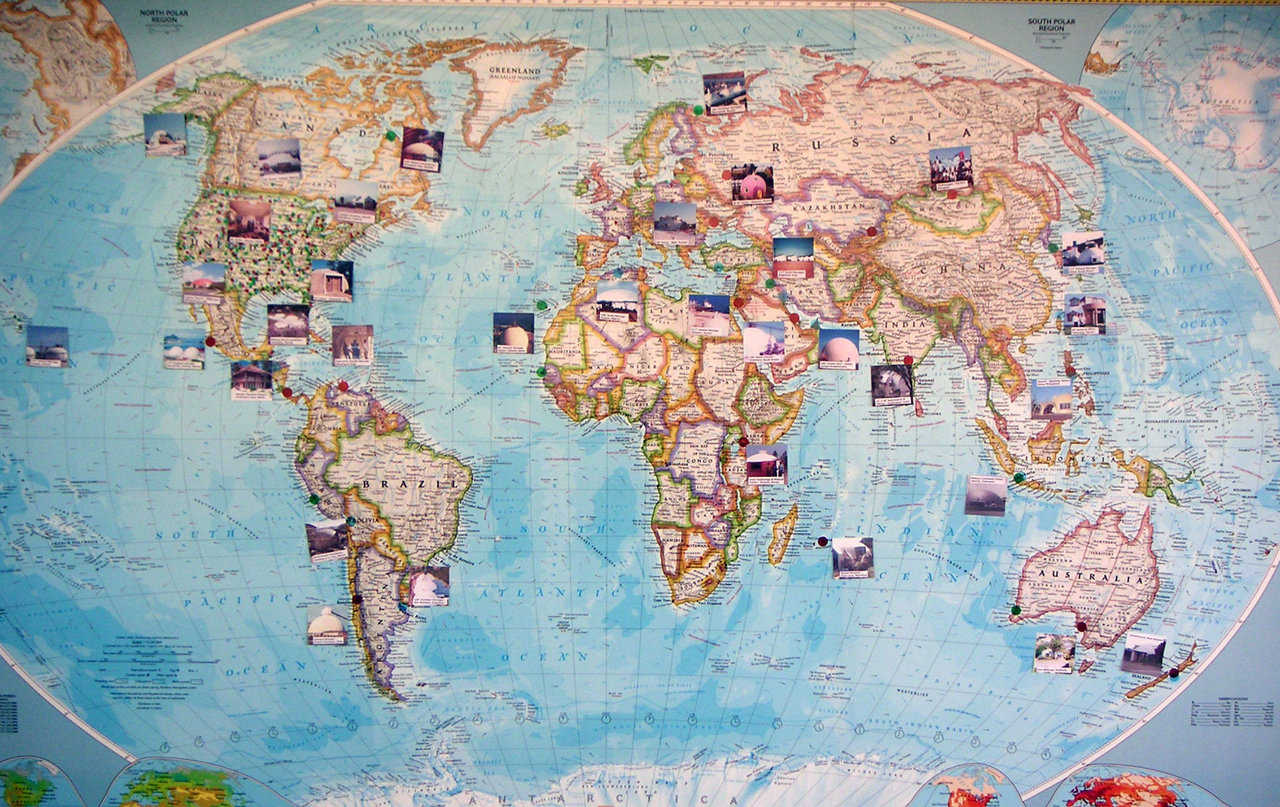 Visitors walking through our front door can immediately see Our Map. It's a full color, National Geographic map of the world, given to us by employees and friends as a Christmas gift.