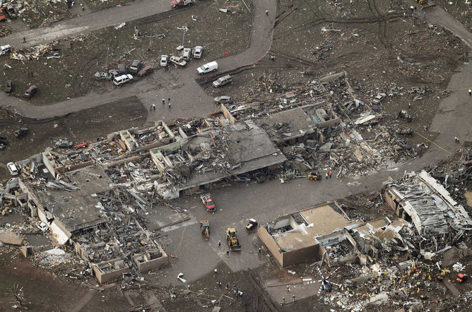 An aerial photo showing damage to Plaza Towers Elementary School after it was hit by a massive tornado in Moore, on May 20, 2013. Rescue workers and a helicopter can be seen at lower right.