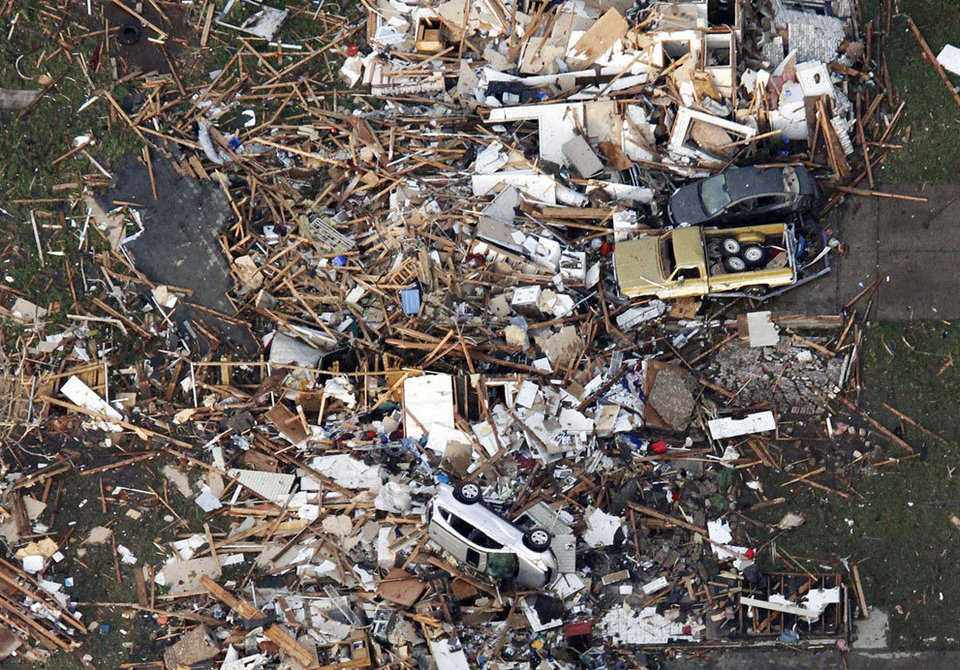 An aerial photo shows the remains of tornado-damaged houses in Moore, on May 20, 2013. A tornado roared through the Oklahoma City suburbs Monday, flattening entire neighborhoods, setting buildings on fire and landing a direct blow on an elementary school.