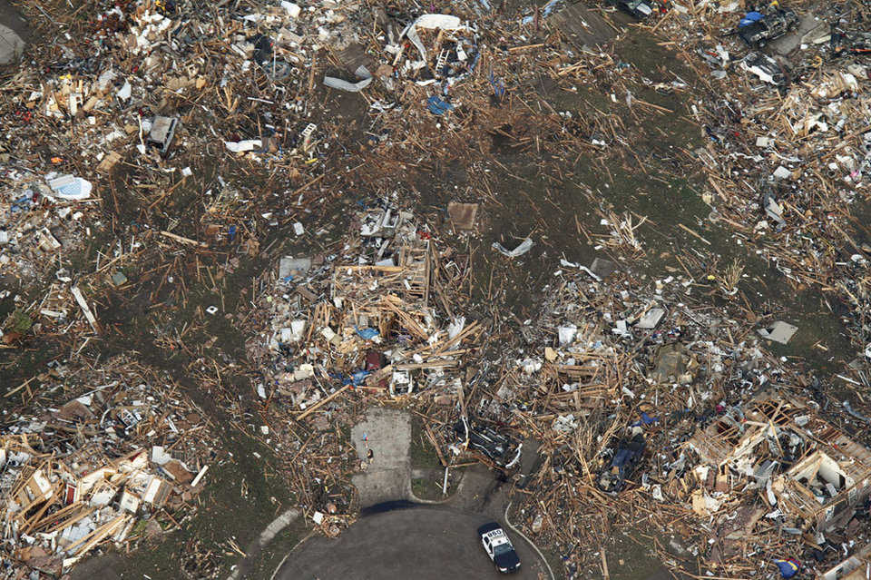 This aerial photo shows the remains of homes, after being flattened by a massive tornado in Moore, Oklahoma, on May 20, 2013.