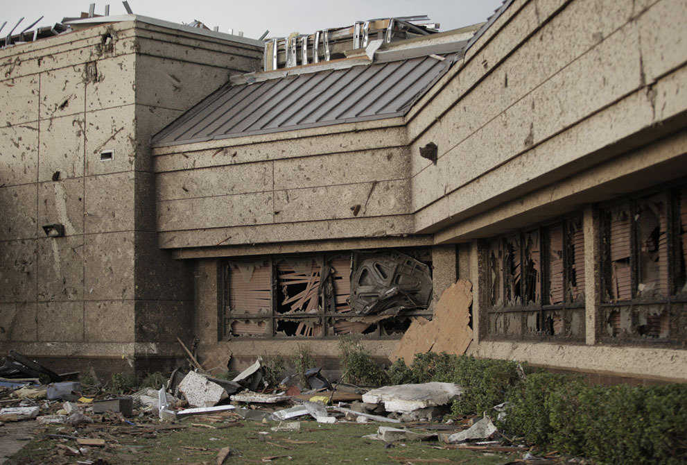 The hood of car is wedged into the front window of the Moore Medical Center after a powerful tornado ripped through the area on May 20, 2013.