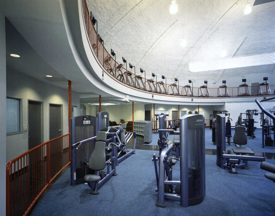 The upper level features a large number of cardio machines overlooking the lower level which provides strength training equipment, locker rooms, sauna and childcare.