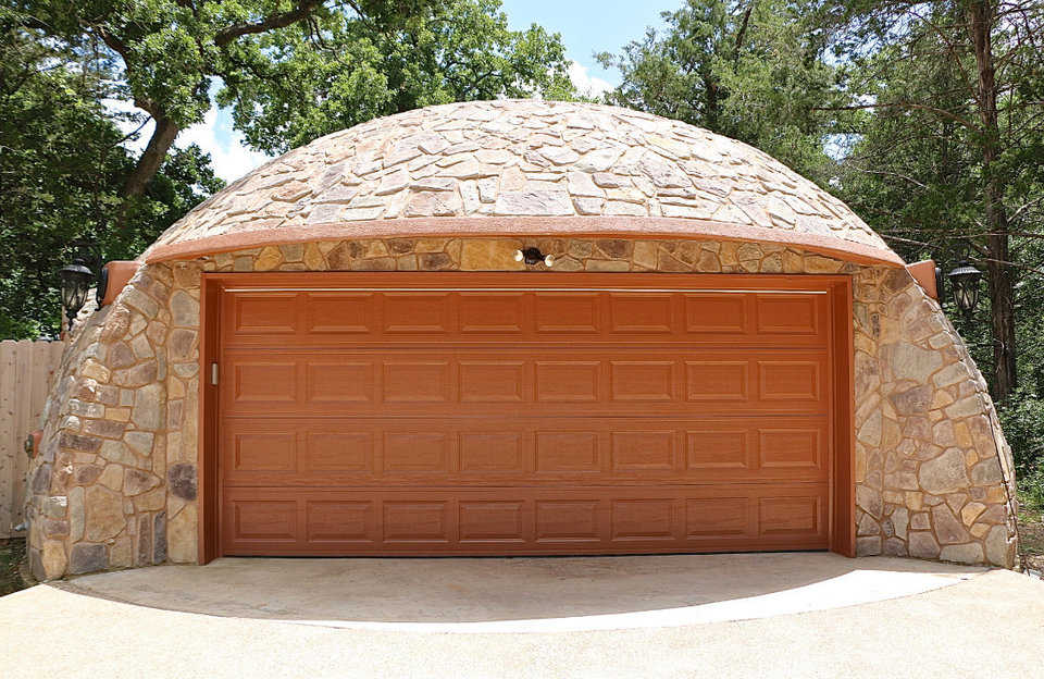 The stone-covered Monolithic Dome garage at the Whiteacre residence.