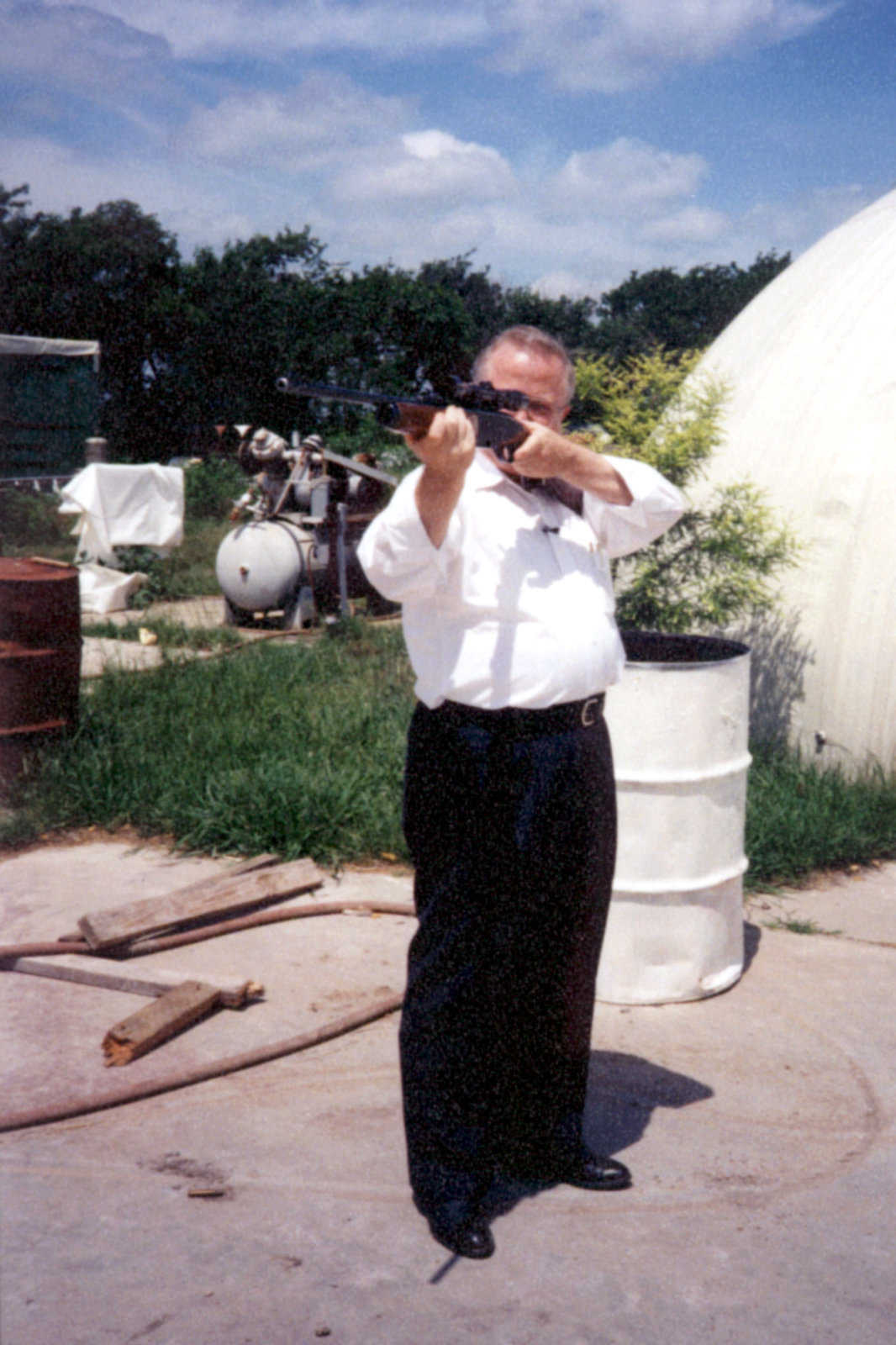 David B. South takes aim at a dome with his .30-06 rifle during a bulletproof demonstration for a Dallas TV station in the late '90s.