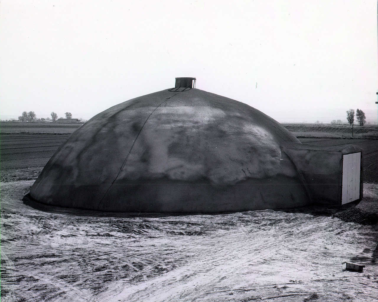 The first dome constructed using Monolithic's patented construction process. Shelley, Idaho – April 1976.