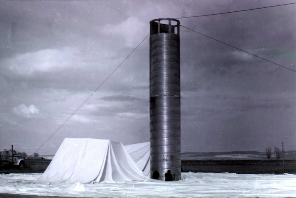 The construction of the first dome built by Monolithic. Pictured, is the air-formed membrane ready to inflate—the first step in Monolithic's patented construction process. Shelley, Idaho – April 1976.