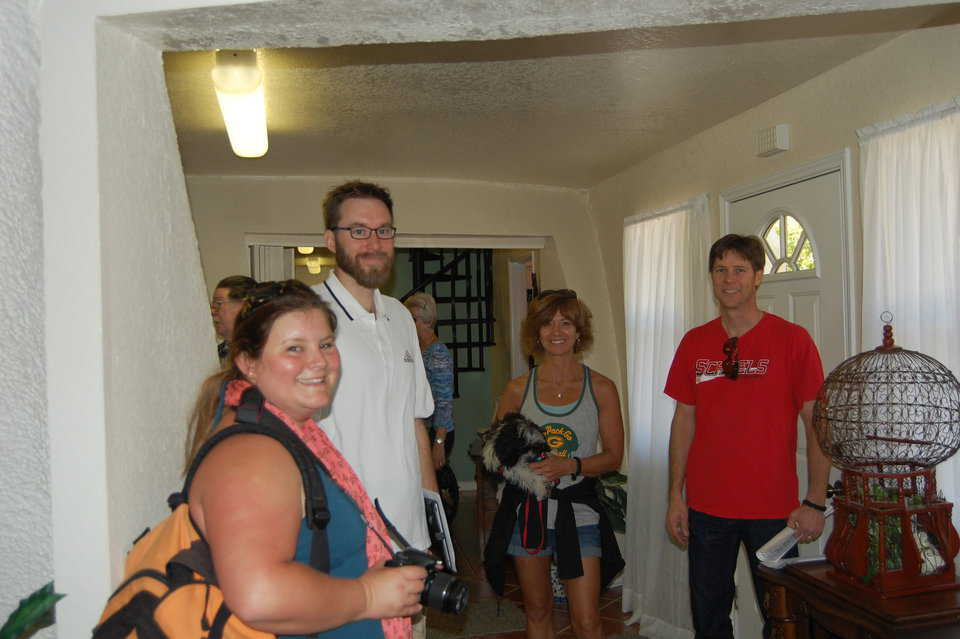 Open house visitors from Wisconsin meet another Wisconsin native in the entryway to Charca Casa.