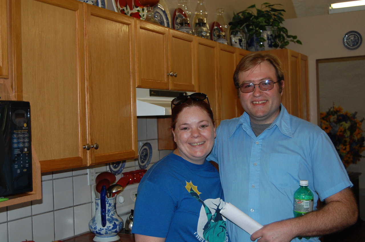 A couple from Arkansas pose for a photo in Charca Casa's kitchen.