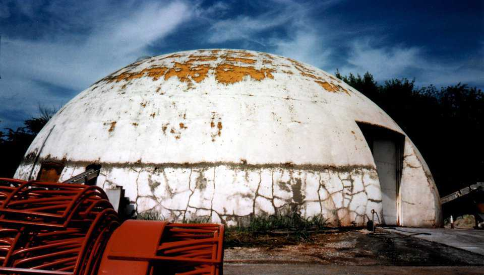 After 35 years, the dome was looking a bit worn. In the 1970s we used to peel the Airform membrane and coat the dome. Turns out to be cheaper and better to leave the membrane on.