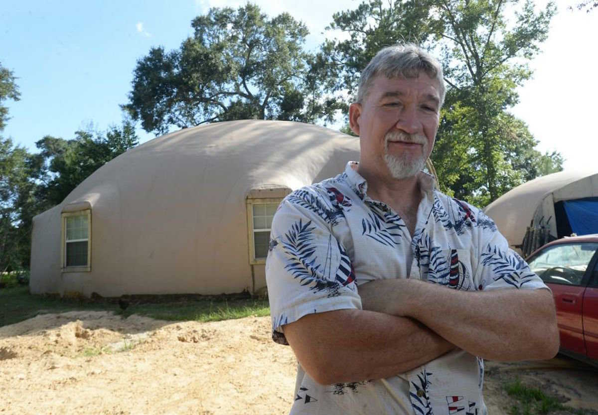 David Smith in front of his Monolithic Dome home near Orange, Texas.