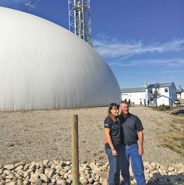 Christina and Andy Stender of Crowfoot Ag in front of their Monolithic Dome fertilizer blend plant.