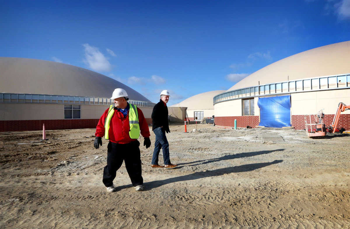 Superintendent Michael Garvey and Johnson Creek School Board president Rick Kaltenberg tour grounds of the new Monolithic Dome high school under construction.