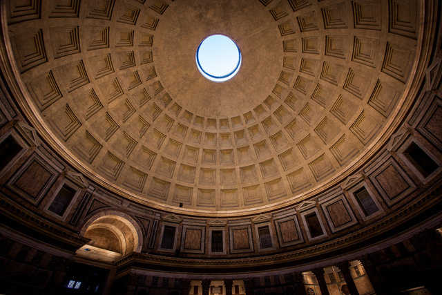 The Eye — Sunlight beams through the Pantheon's oculus, down upon a throng of tourists.