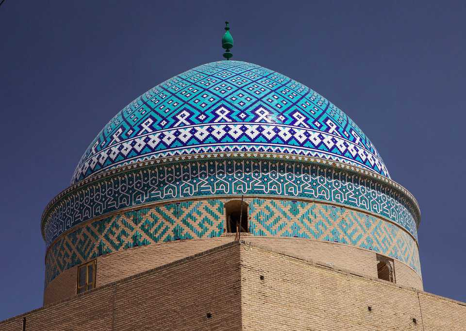 Yazd, Iran — Intricate decorative tile pattern covers this famous mosque.