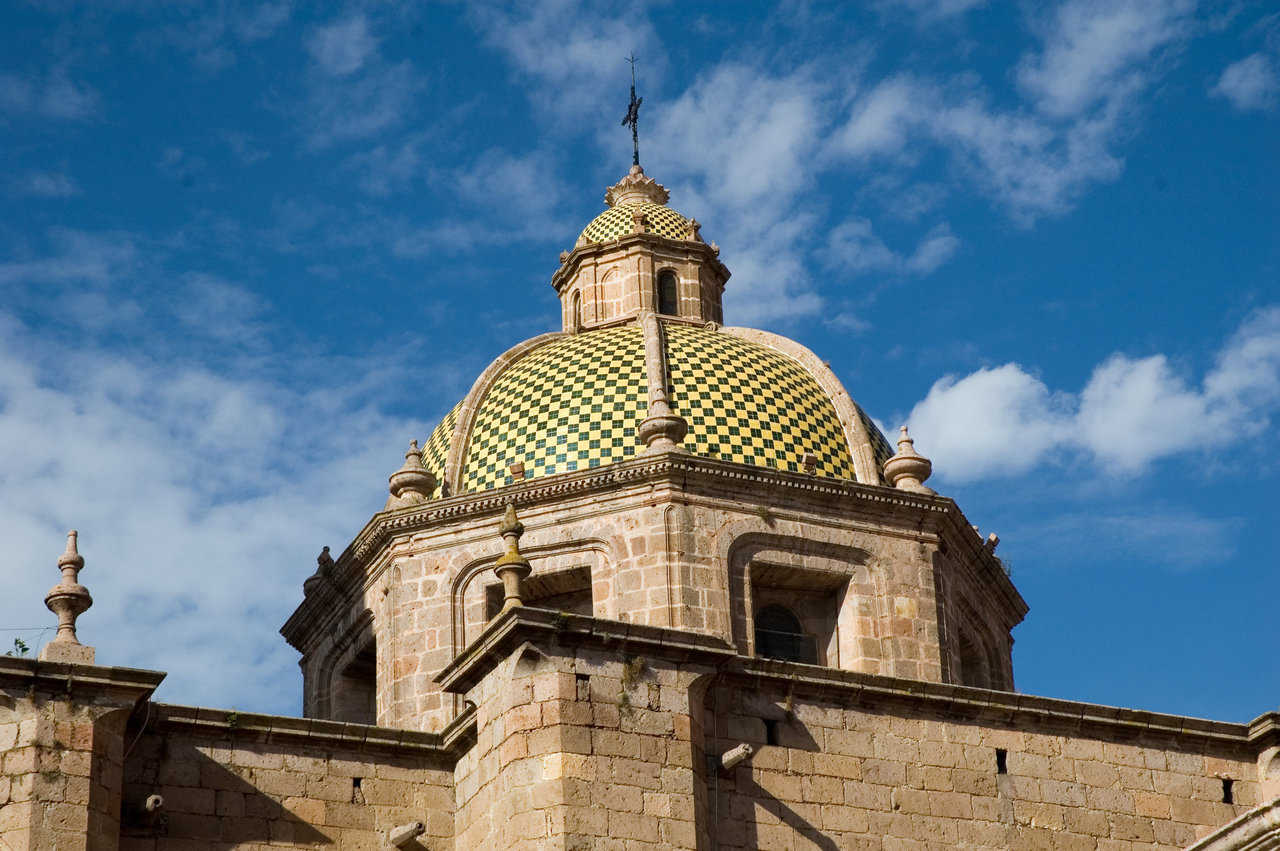 Morelia, Mexico — This brightly tiled dome sits beneath a clear, blue sky.