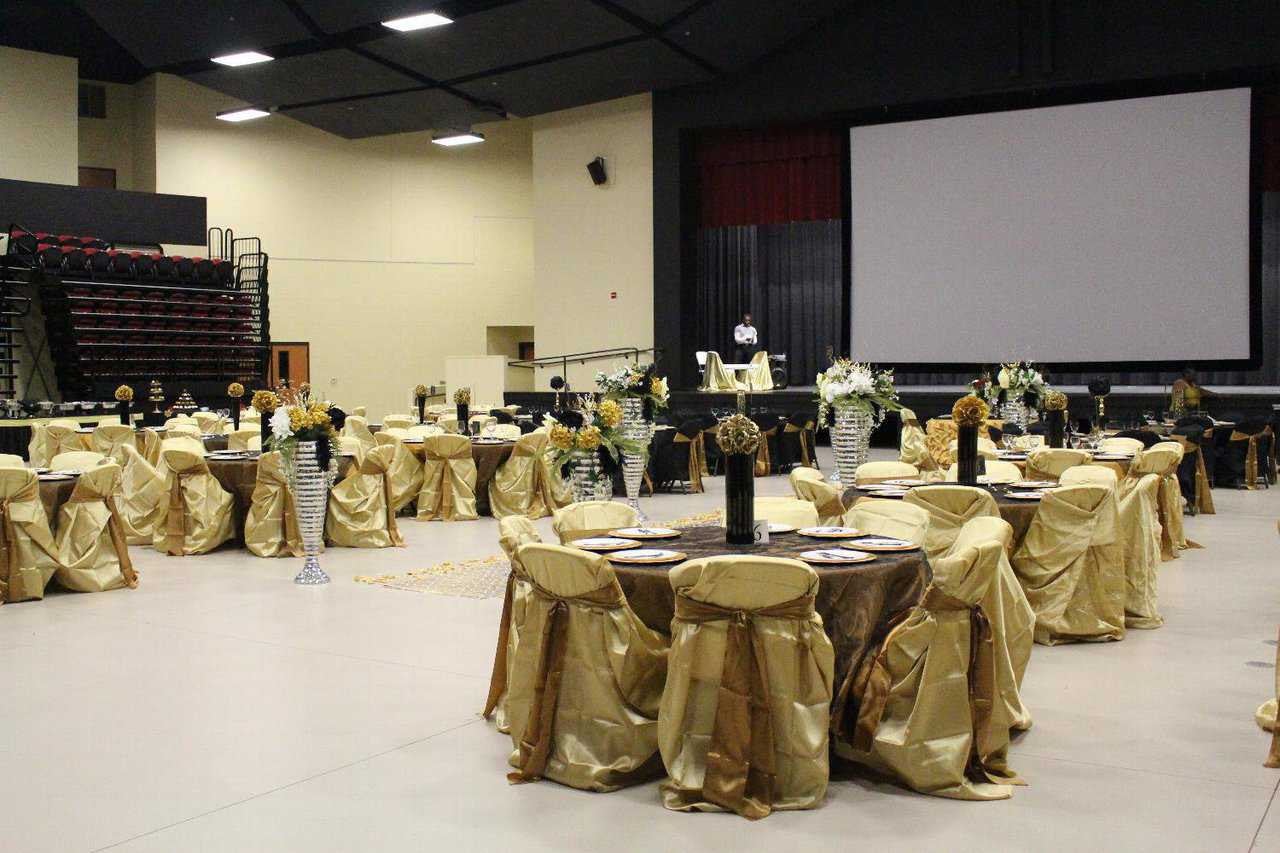 The seats pulled back and more tables and chairs set up for a banquet.