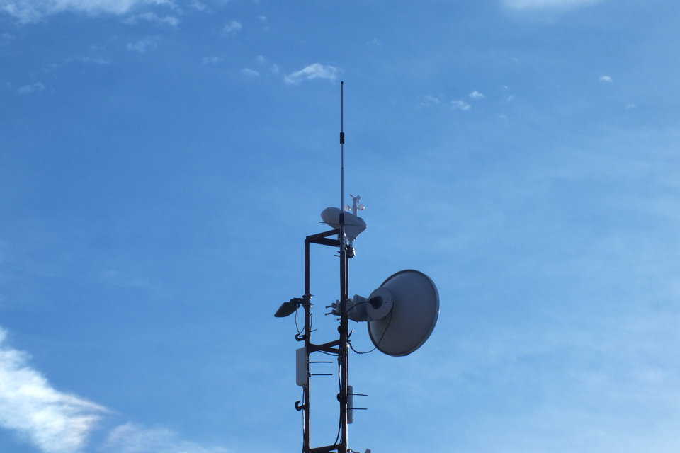 The weather station was installed to the top of the WiFi mast at Monolithic.