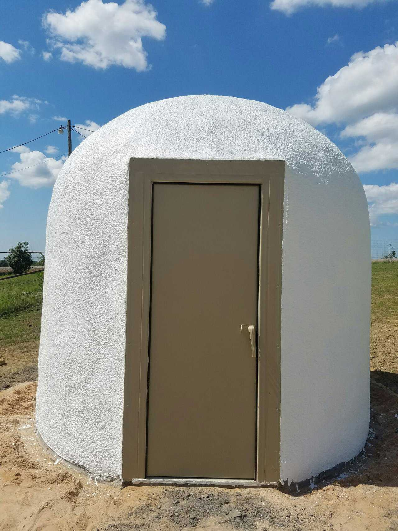 The Tornado Tamer storm door completes the tornado shelter. & A Minion ready to protect against storms | Monolithic Dome Institute