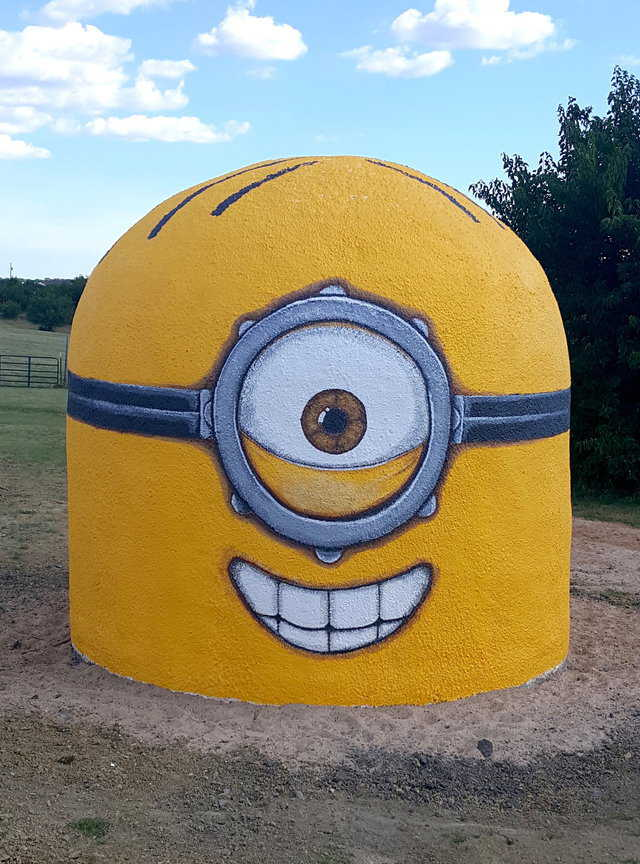An Ecoshell tornado shelter painted as a Minion from Despicable Me.