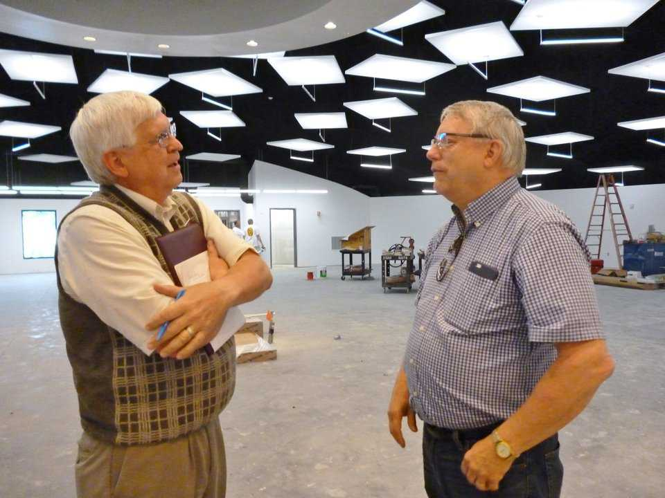 Kasson Library director Art Tiff speaks with architect Leland Gray