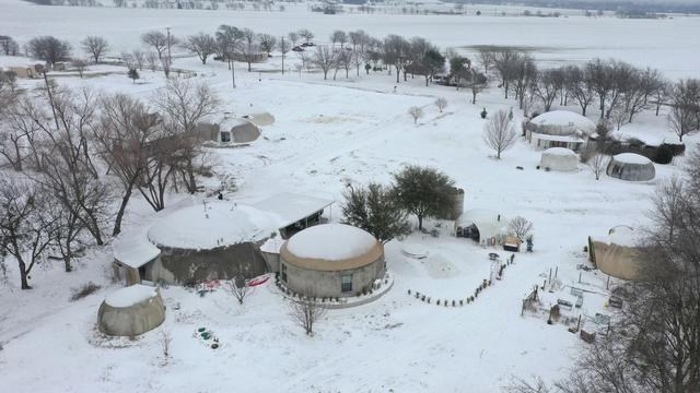 Winter snow covering Monolithic Dome Research Park near Italy, Texas